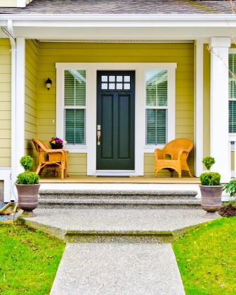 yellow and green front porch