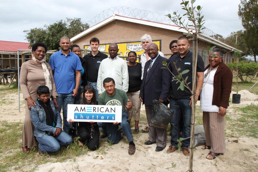 AMERICAN shutters staff planting trees in Khayelitsha in honour of Arbour month 2011.