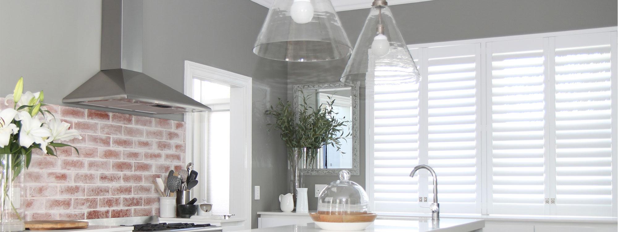 Decowood-shutters-white-kitchen-flowers-open-plan
