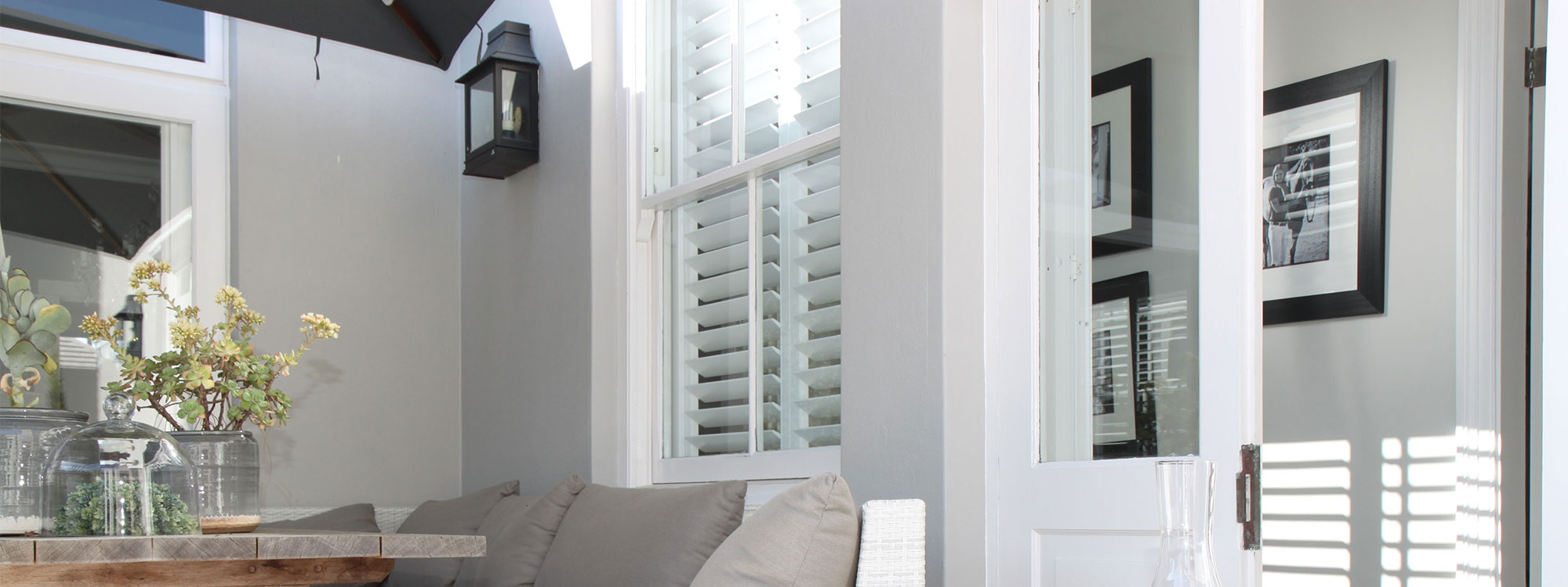Decowood-shutters-white-living-area-outside-window