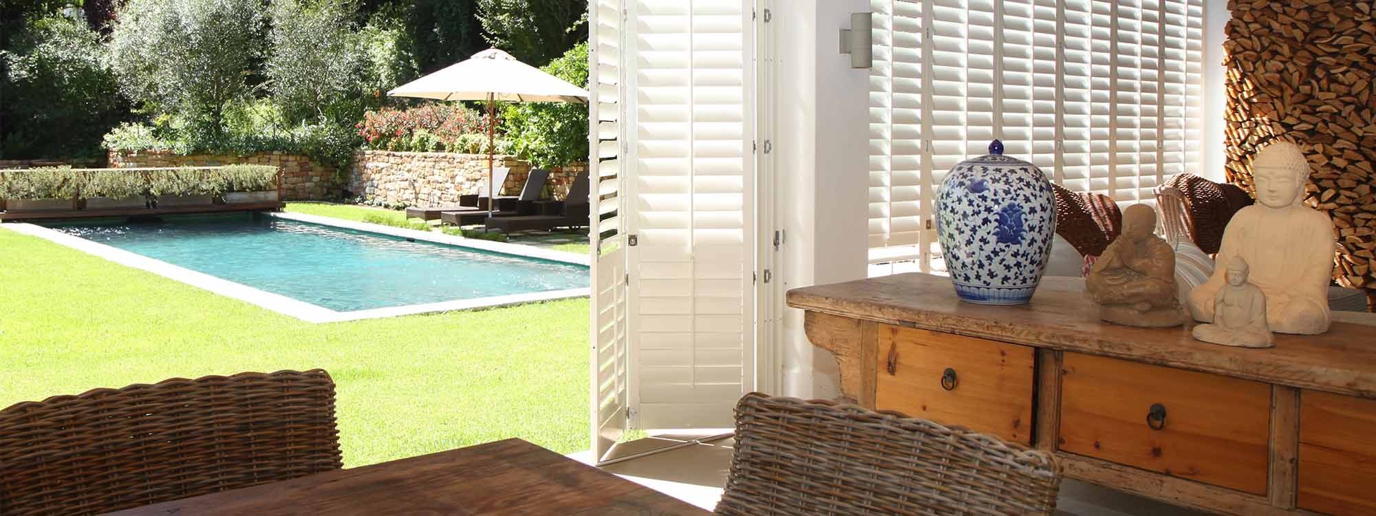 Decowood-shutters-patio-pool-view-summer