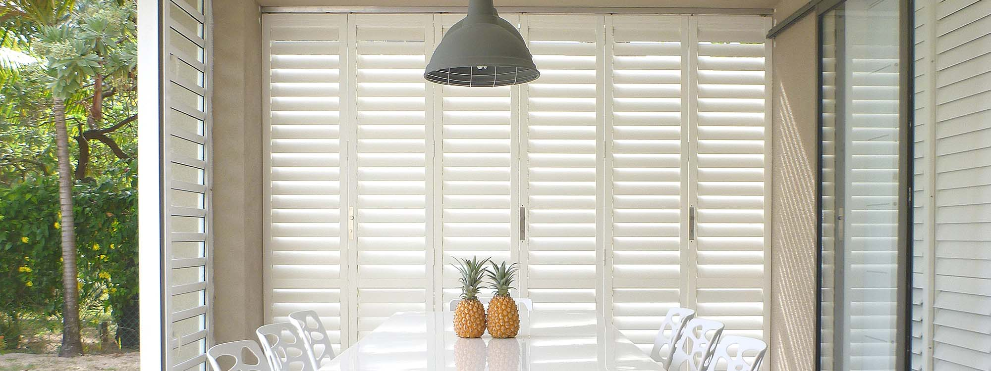 Security-shutters-patio-pineapple-dining